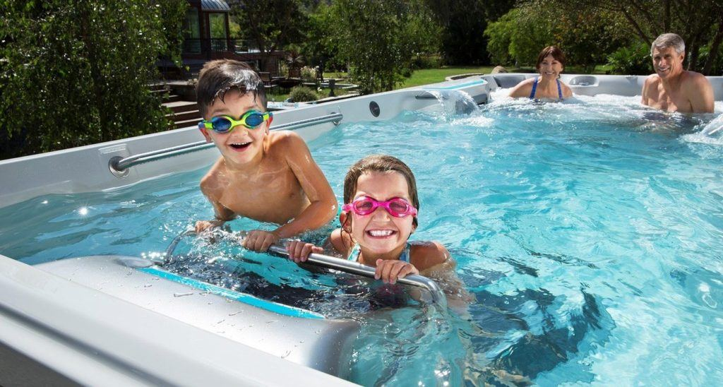 Family with young kids in endless swimming pool