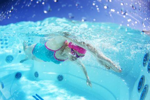 Lady Swimming in Endless Pool