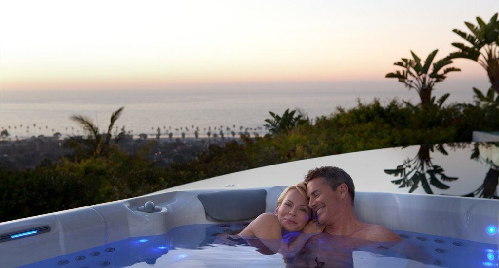 Middle aged couple relaxing in hot tub