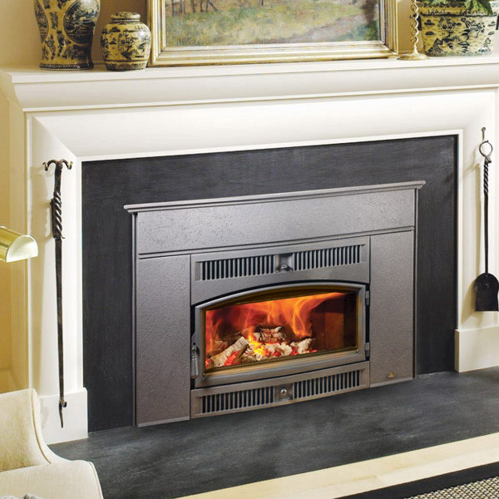 cape cod fireplace insert in elegant mantle