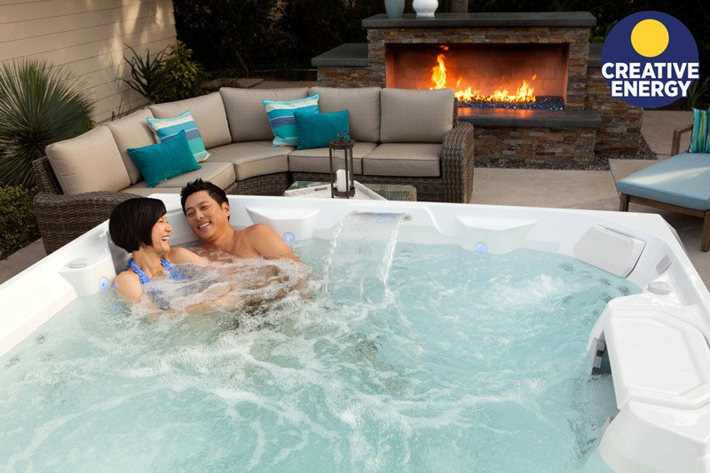 A couple enjoying their new 2018 Limelight hot tub.