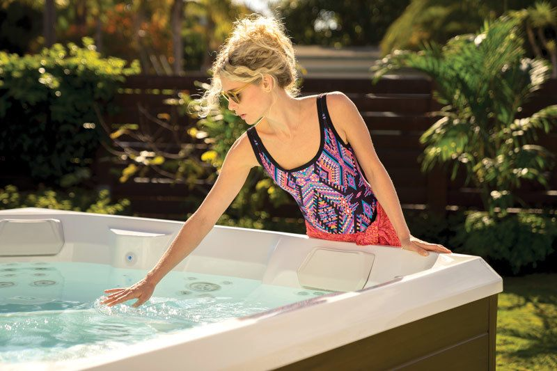 woman checking water in new 2019 hotspring spa