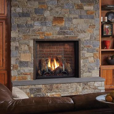 clean face fireplace insert in stone hearth