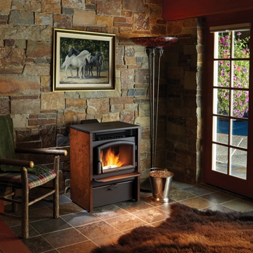 pellet stove in stone walled room