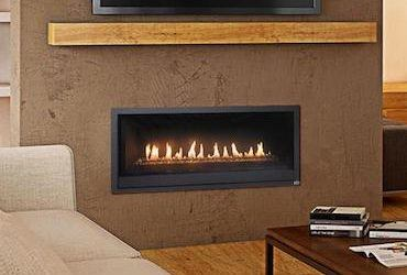 gas fireplace set into living room wall