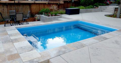 swim spa installed completely in ground in backyard