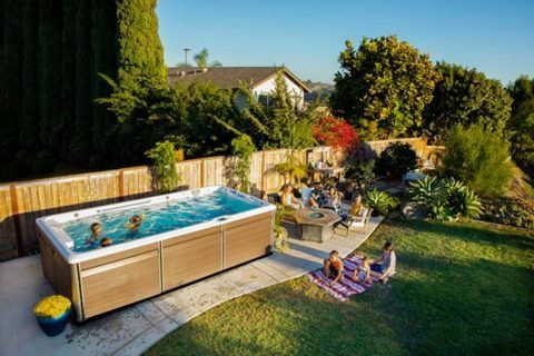 Backyard makeover for summer with endless pool, hot tubs and fire pits