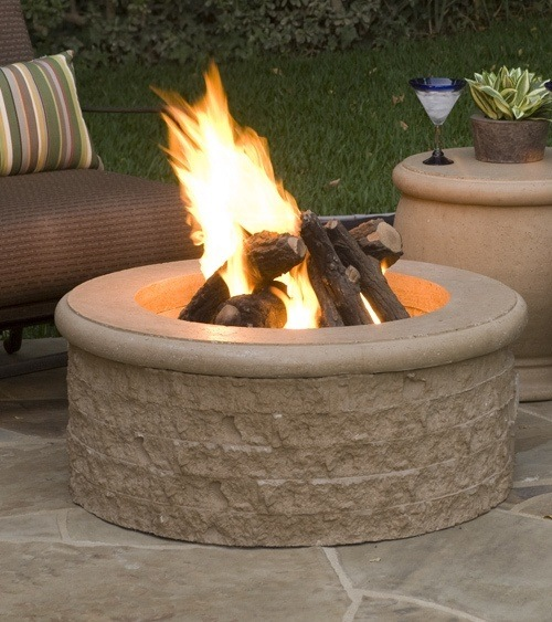 beautiful fire pit in a backyard on a summer evening