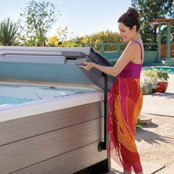 Woman opening a Hot Tub using a Hydraulic Lift Cover