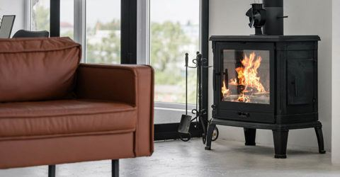 a freestanding wood burning stove in a beautiful modern living rom