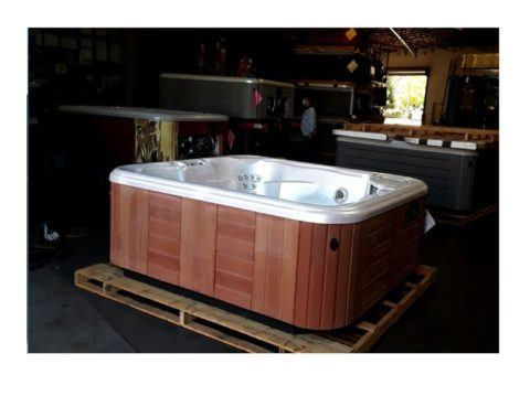 hot tub with wood panel exterior