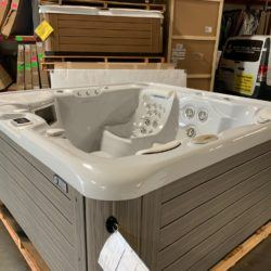 hot tub with grey interior and dark gray wood exterior