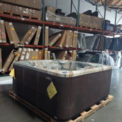 hot tub with marbled interior and dark espresso wood exterior