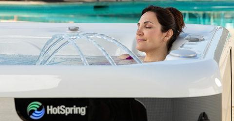 Women relaxing in a Hot Springs hot tub with waterfall feature