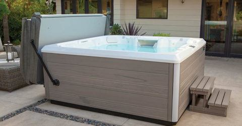 brand new hot tub installed in backyard