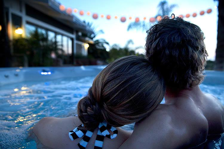 Couple enjoying a Romantic Valentine's Day Experience at Home with their HotSprings Spa