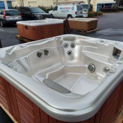 Hot tub on pallete with wood grain exterior