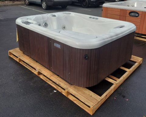 hot tub on palette with wood grain exterior