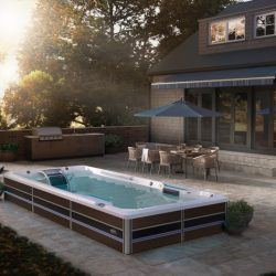 Semi in-ground swim spa with surrounding patio at dusk