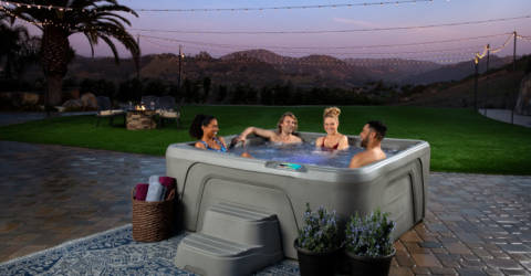 Family and Friends enjoying a hot tub on a Summer evening